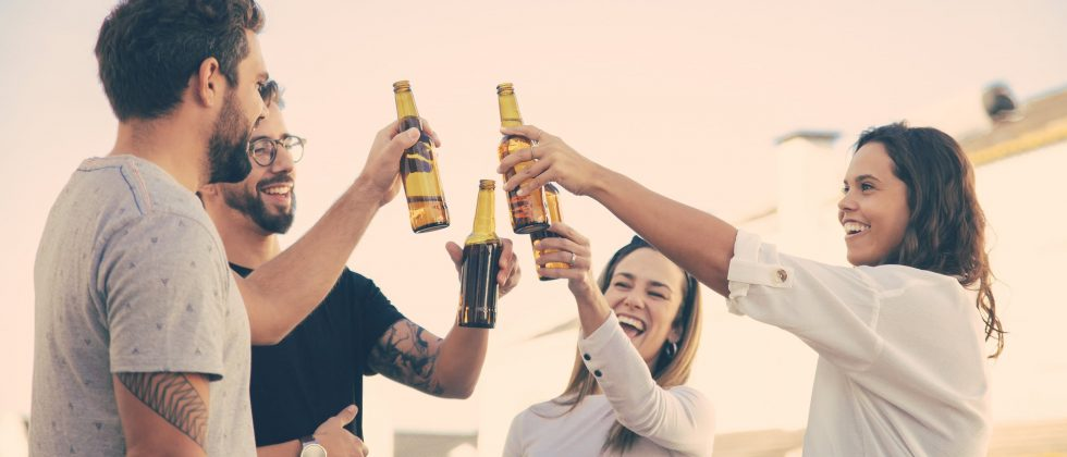 A group of friends toasting beers