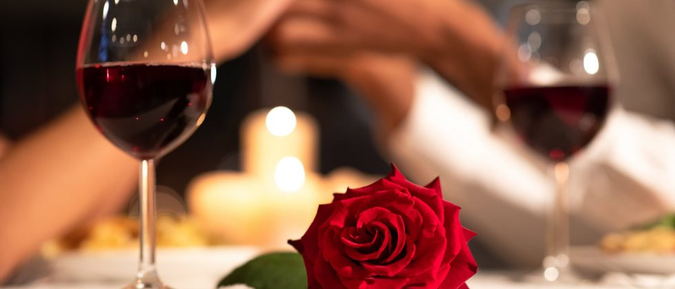 Red wine and a red rose
