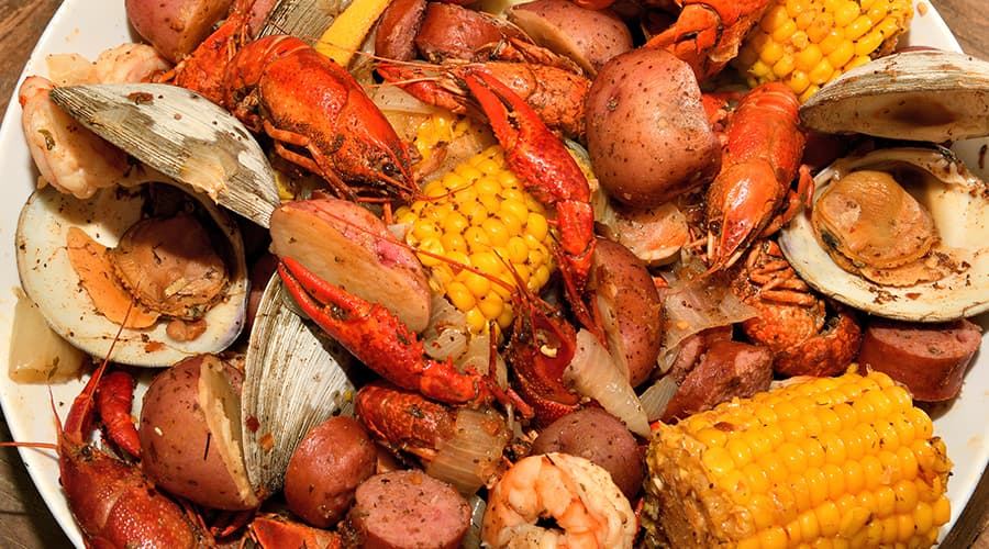 Low Country boil with crawdads, sausage, potatoes and corn