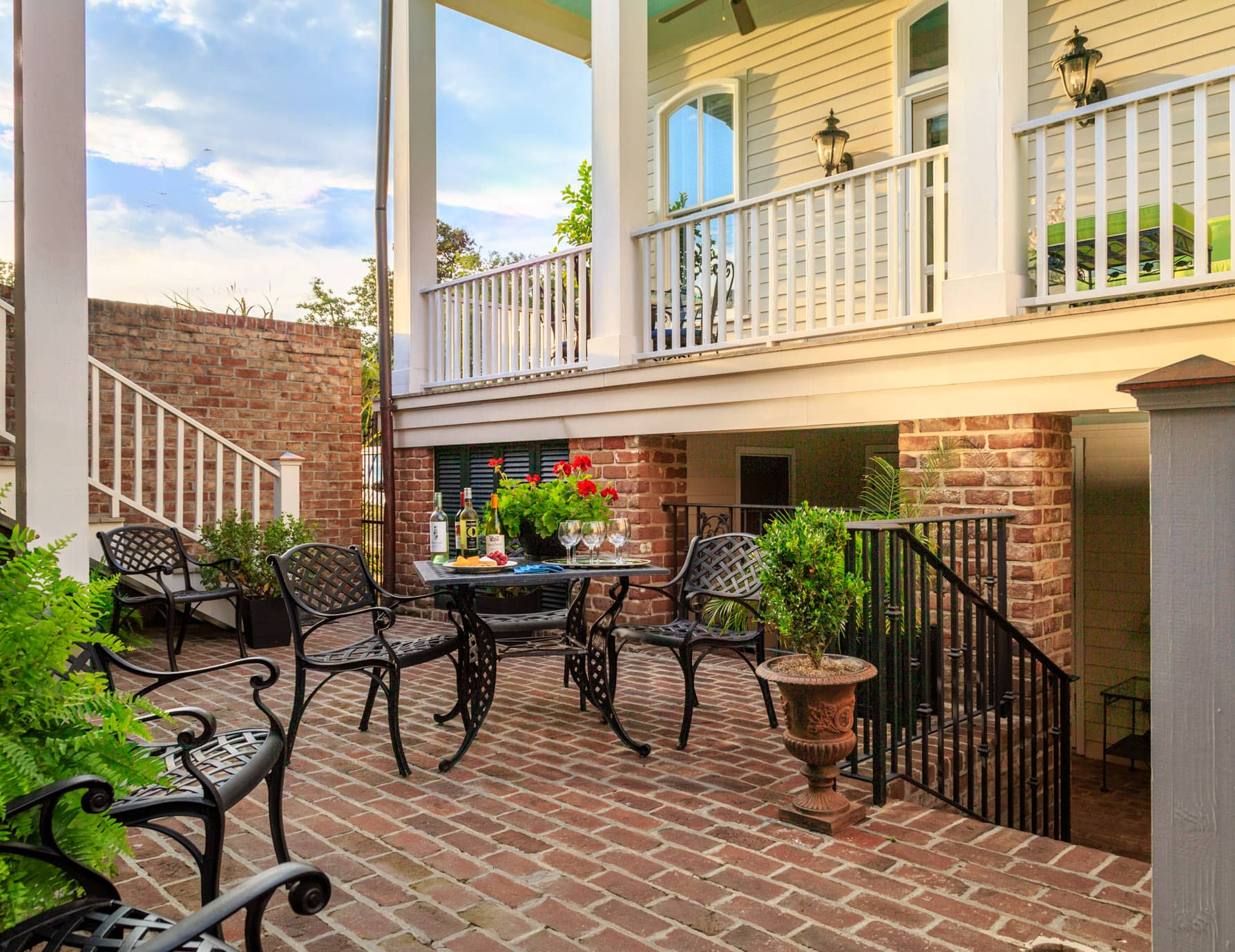 Red brick patio courtyard with tables and chairs