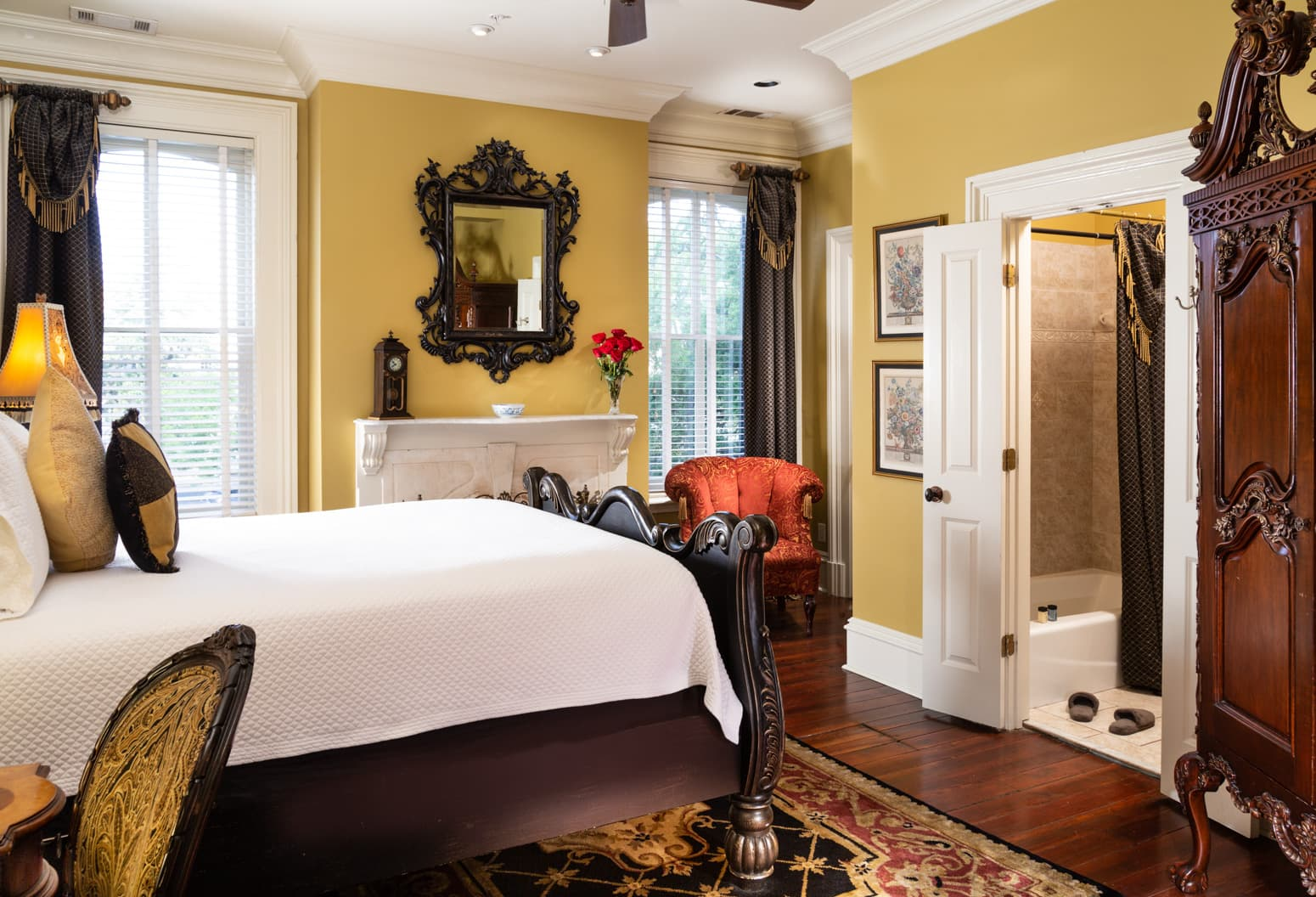 Bed in the Madison Square room with lavish furnishings and a walk-in shower