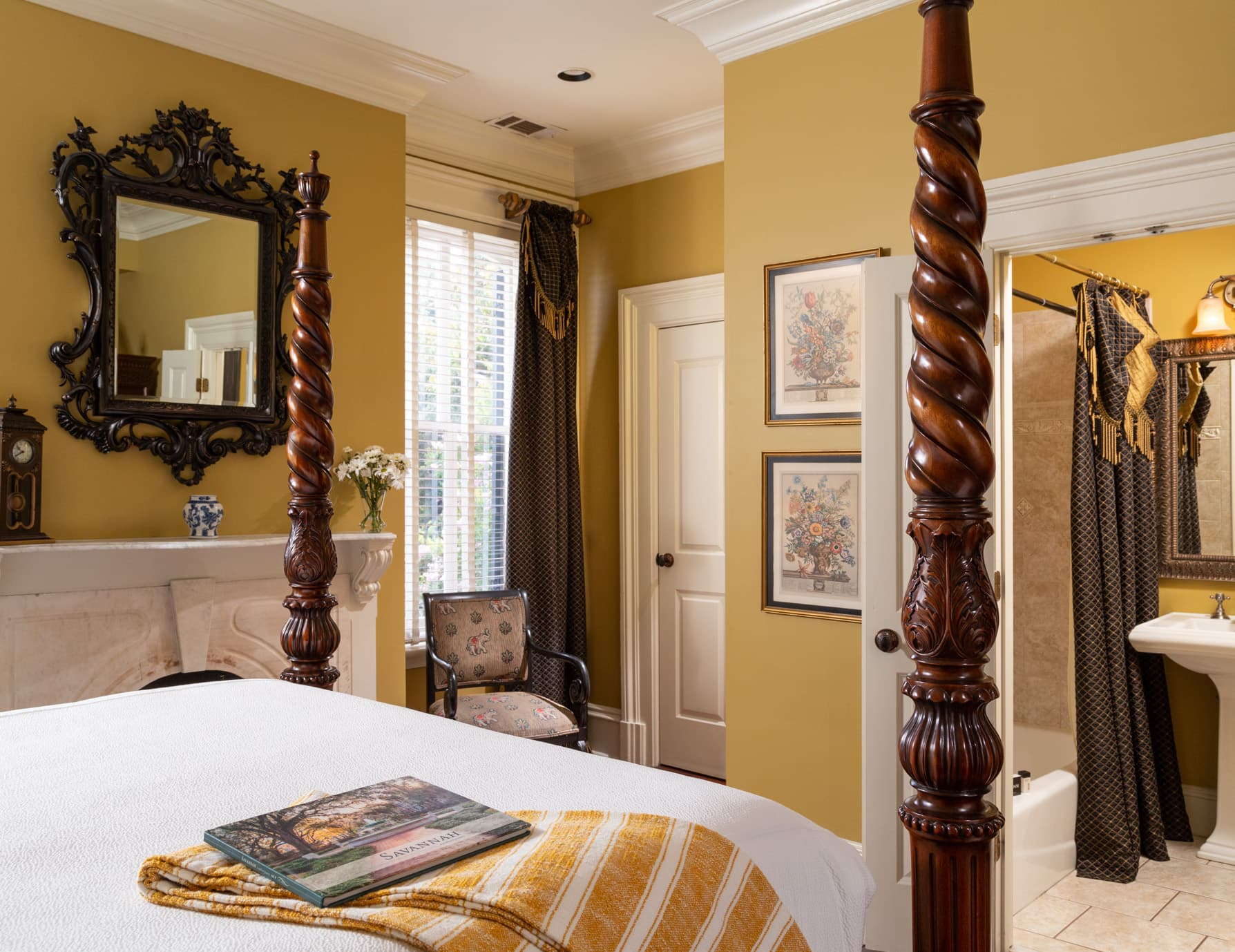 Foot of a queen bed with a view of the private bathroom