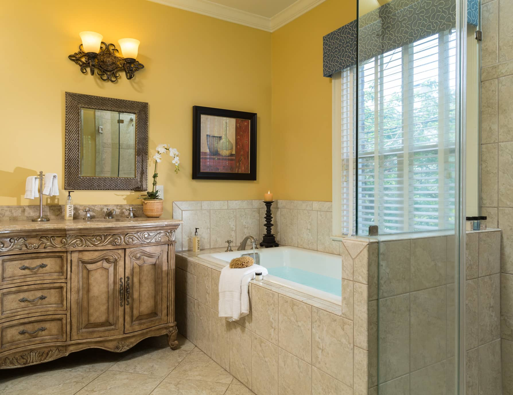 A large soaking tub and separate glass walk-in shower in a spacious bathroom