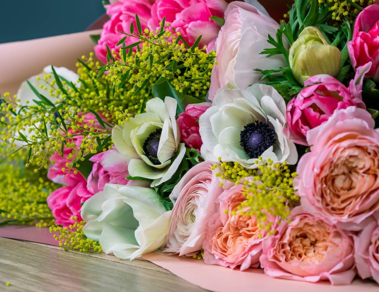 A bouquet of seasonal flowers on a table