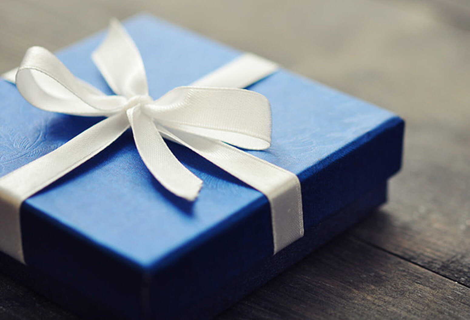 blue gift box with a white ribbon