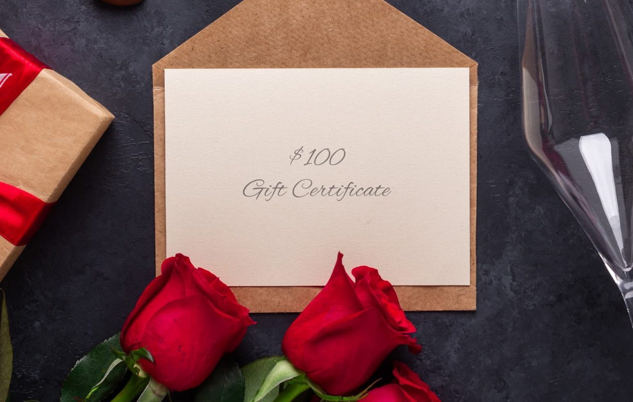 Roses, champagne flutes, a gift card and chocolates