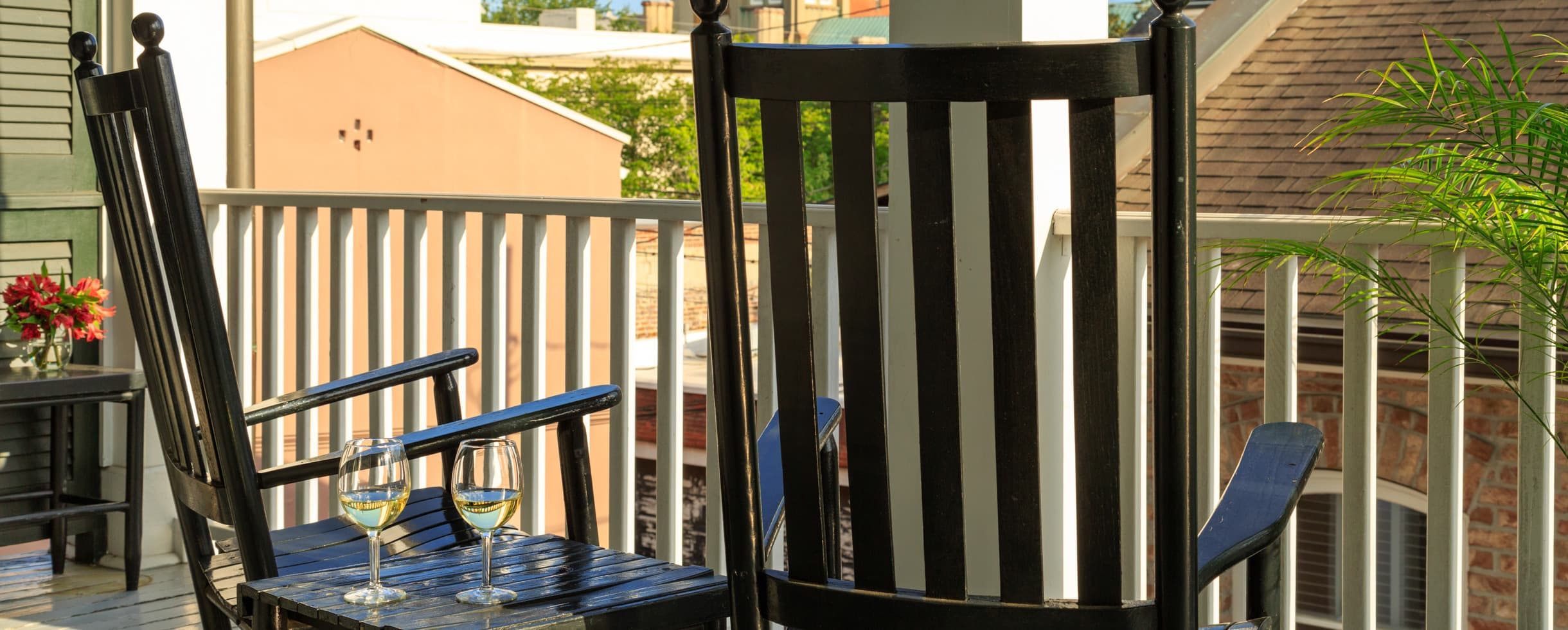 Two rocking chairs on a balcony overlooking Savannah, GA