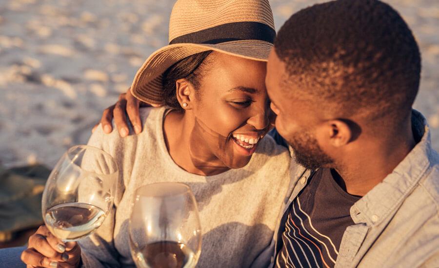 Couple on Savannah Honeymoon Enjoying Wine on the Beach