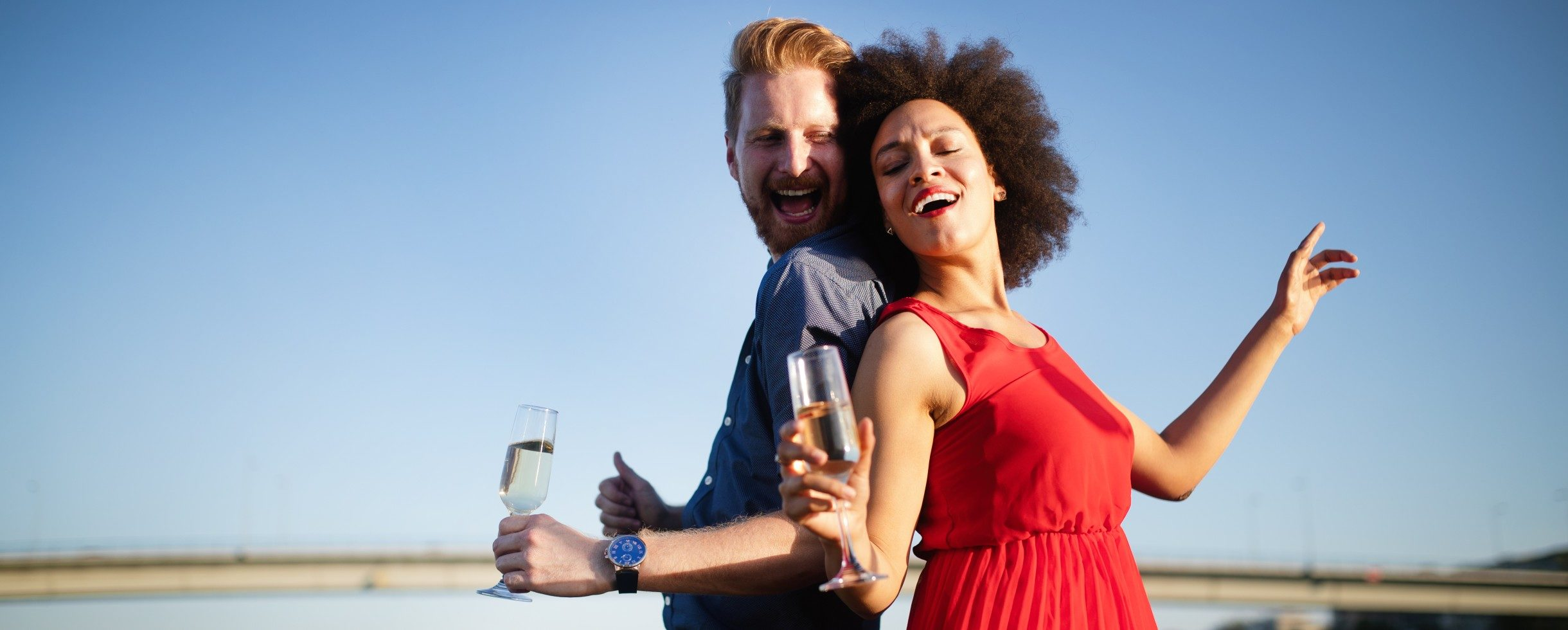 smiling couple in love holding champagne glasses