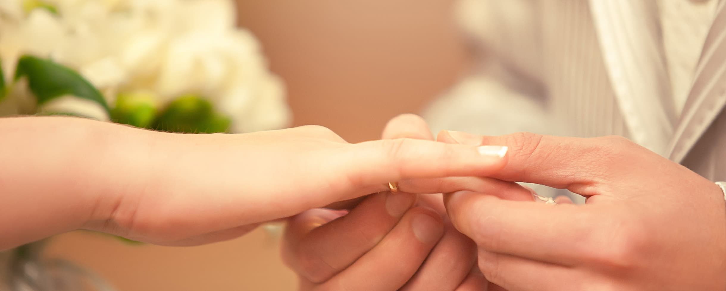 groom placing ring on bride's finger during elopement ceremony