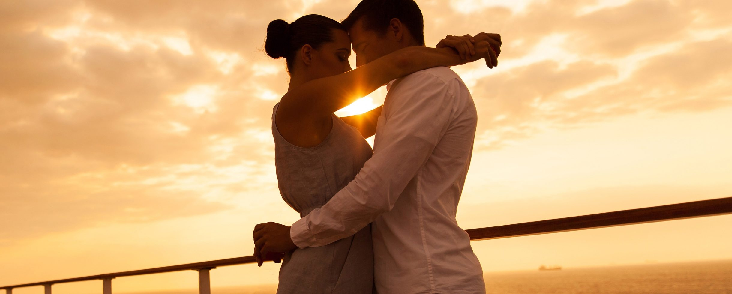 couple in sunset sailing background