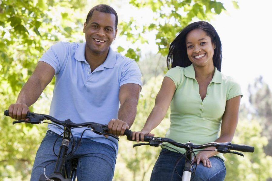 african american couple on bikes